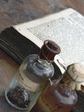 Medicine bottles. And vintage book in the background Royalty Free Stock Photos