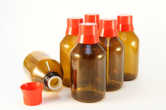 Medicine bottles. Six bottles for medical fluids with red caps Royalty Free Stock Photos