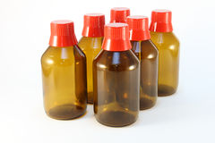 Medicine bottles. Six bottles for medical fluids with red caps Royalty Free Stock Photography