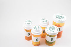 Medicine Bottles. Prescription Medicine Pill Bottles with dollar sign labels Stock Photo
