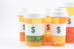 Medicine Bottles. Prescription Medicine Pill Bottles with dollar sign labels Stock Images