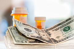 Medicine Bottles And Money Royalty Free Stock Photo