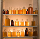 Medicine bottles cabinet. 25 colorful medicine bottles, old pharmacy, diversity and ethnicity Stock Photography