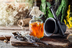 Medicine in bottles made of honey and fresh herbs Royalty Free Stock Photos