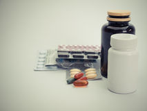 Medicine bottles and piles of medicines , Royalty Free Stock Photos