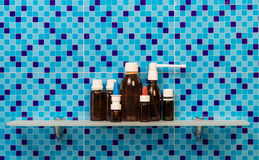 Medicine bottles on shelf Royalty Free Stock Images