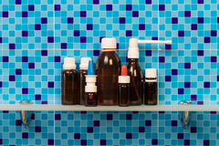 Medicine bottles on shelf Stock Photo