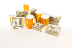 Medicine Bottles and Stacks of Hundreds of Dollars Royalty Free Stock Photo