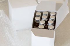 Medicine bottles in white paper box and air bubble Royalty Free Stock Photos