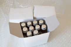 Medicine bottles in white paper box and air bubble Stock Photo