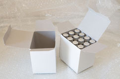 Medicine bottles in white paper box and air bubble Royalty Free Stock Photo