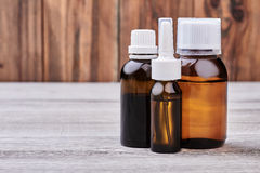 Medicine bottles on wooden background. Royalty Free Stock Images