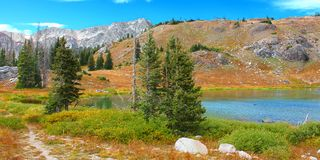 Medicine Bow Lake Landscape Wyoming. Bellamy Lake below the rugged mountains of the Snowy Range in Medicine Bow National Forest of Wyoming stock photography