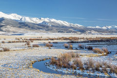 Medicine Bow Mountains. Meanders of Canadian River and Medicine Bow Mountains in North Park near Walden, Colorado, late fall scenery stock image