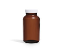 Medicine brown bottle. Original shadow, white cap, brown bottle. White background. Sun protection bottle. Take a photo from the other side,  Medical product Royalty Free Stock Photo