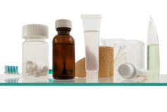 Medicine cabinet. Clean and simple view of a shelf in a modern medicine cabinet royalty free stock photo