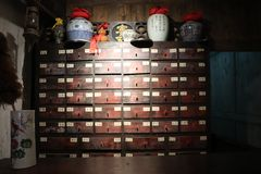 Medicine cabinet of Chinese Medicine Museum. Chinese medicine cabinet is full of Chinese herbal medicines. These Chinese medicines are mostly made by ancient stock images