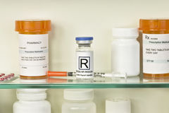 Medicine Cabinet Insulin. Vial of regular insulin and syringe on medicine cabinet shelf. Labels are fictitious and created by the photographer royalty free stock photos
