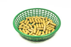 Medicine capsule in a basket isolated Stock Photo