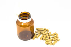 Medicine capsule with a bottle Royalty Free Stock Photography