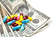 Medicine capsules and banknotes 1 Stock Photo