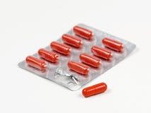 Medicine capsules. Orange Medicine capsules in plastic Royalty Free Stock Photos