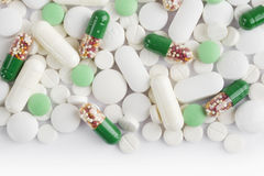 Medicine capsules, pills and tablets background with copy space Stock Image