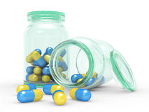 Medicine capsules spilled from the pill bottle Stock Photos