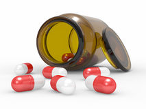 Medicine capsules spilled from the pill bottle Royalty Free Stock Images