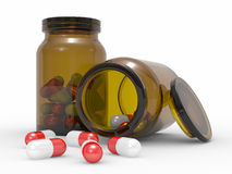 Medicine capsules spilled from the pill bottle Royalty Free Stock Photo