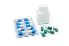 Medicine capsules with white bottle Royalty Free Stock Photo