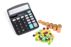 Medicine,coins and calculator Stock Photo