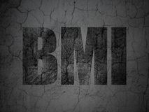 Medicine concept: BMI on grunge wall background. Medicine concept: Black BMI on grunge textured concrete wall background Stock Photo