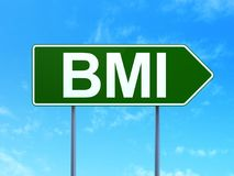 Medicine concept: BMI on road sign background. Medicine concept: BMI on green road highway sign, clear blue sky background, 3D rendering Royalty Free Stock Photos