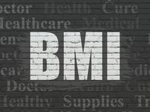 Medicine concept: BMI on wall background. Medicine concept: Painted white text BMI on Black Brick wall background with  Tag Cloud Royalty Free Stock Photography