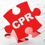 Medicine concept: CPR on puzzle background Royalty Free Stock Photo