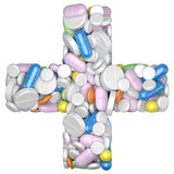 Medicine concept. Cross shape with with pills and capsules. Stock Photos