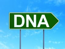 Medicine concept: DNA on road sign background Royalty Free Stock Images