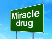 Medicine concept: Miracle Drug on road sign background. Medicine concept: Miracle Drug on green road highway sign, clear blue sky background, 3D rendering Stock Images