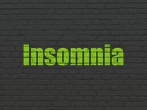 Medicine concept: Insomnia on wall background. Medicine concept: Painted green text Insomnia on Black Brick wall background Royalty Free Stock Photography