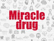 Medicine concept: Miracle Drug on wall background. Medicine concept: Painted red text Miracle Drug on White Brick wall background with  Hand Drawn Medicine Icons Stock Photography