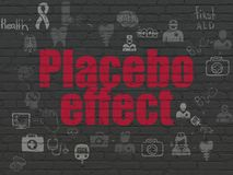 Medicine concept: Placebo Effect on wall background. Medicine concept: Painted red text Placebo Effect on Black Brick wall background with Scheme Of Hand Drawn Royalty Free Stock Photography