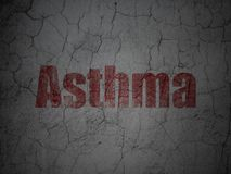 Medicine concept: Asthma on grunge wall background. Medicine concept: Red Asthma on grunge textured concrete wall background Stock Photo