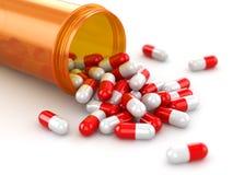 Medicine concept. Spilled pills from prescription bottle. Stock Photo