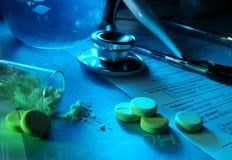Medicine concept. Syringe, stethoscope, tablets and powder. Medicine concept Stock Photography