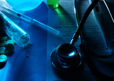 Medicine concept. Tablets, Syringe, stethoscope and powder on medical billing statement. Selective focus Royalty Free Stock Photo