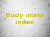 Medicine concept: Body Mass Index on wall background. Medicine concept: Yellow Body Mass Index on textured concrete wall background royalty free illustration