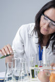 Medicine Concepts. Female Laboratory Staff Working with Flasks and Fruits Specimens in Laboratory Environment Stock Images