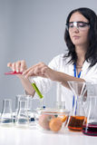 Medicine Concepts and Ideas. Female Laboratory Staff Working with Flasks and Fruits Specimens in Laboratory Environment Stock Photography