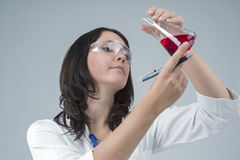Medicine Concepts and Ideas. Female Laboratory Staff Working with Flasks and Liquids in Lab Royalty Free Stock Images
